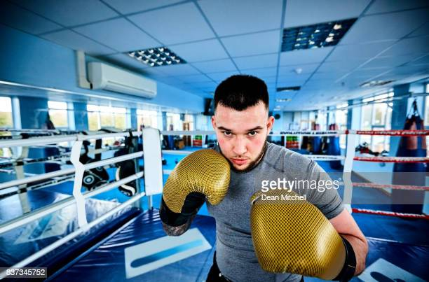 Young man boxing at fight club