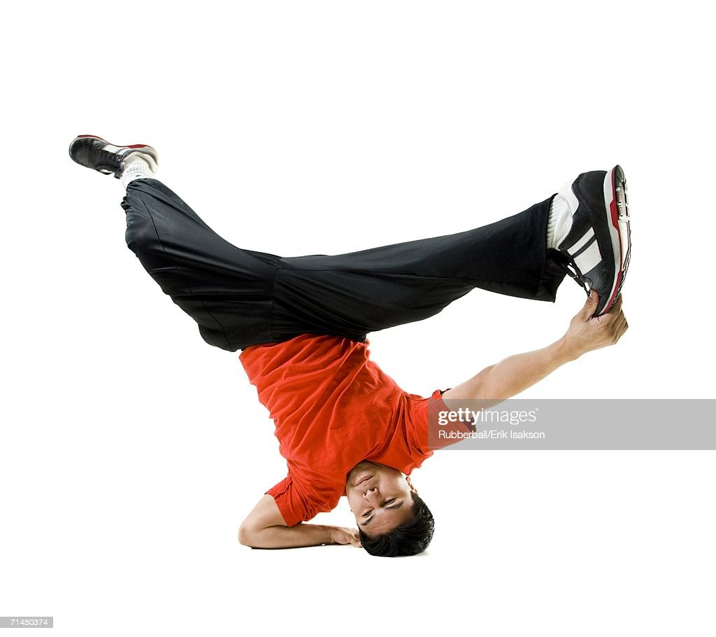 Young man break dancing : Stock Photo