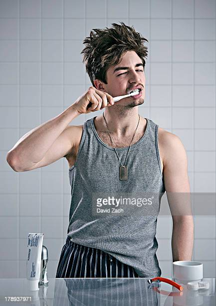 Young man brushing teeth