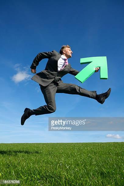 Young Man Businessman Jumping Outdoors Green Arrow Blue Sky Meadow