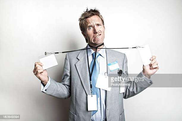 Young Man Businessman Looking Confused with ID Tags
