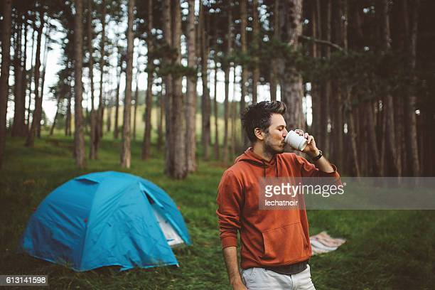 Young man camping in the forest