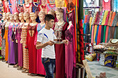 A young man carries tea through the bazaar of the Kurdish city of Sulaimaniyah On June 10th ISIS fighters took control of the Iraqi city of Mosul...