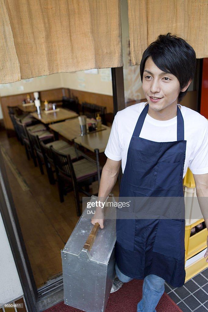 Young man carrying Okamochi