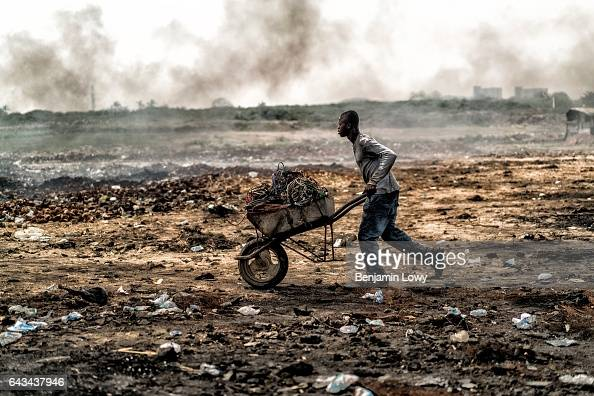 A young man carts electronic waste destined for the Agbogbloshie dump's burning fields where young men almost all internal migrants from Ghana's...