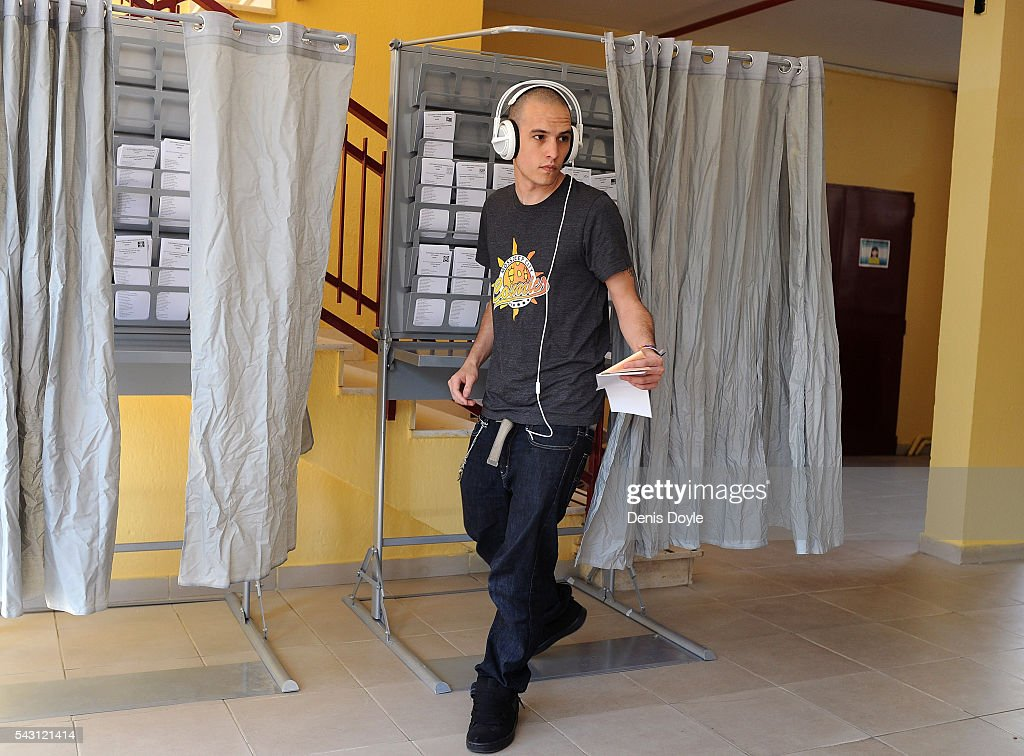 A young man casts his vote for the Spanish general election on June 26, 2016 in Madrid, Spain. Spanish voters head back to the polls on June 26 after the last election in December failed to produce a government. Latest opinion polls suggest the Unidos Podemos left-wing alliance could make enough gains to come in second behind the caretaker government of the center-right Popular Party.
