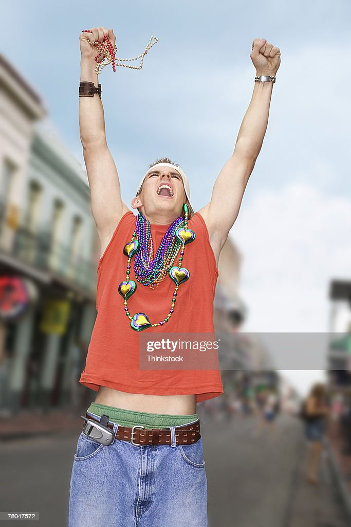 Young man celebrating mardi gras