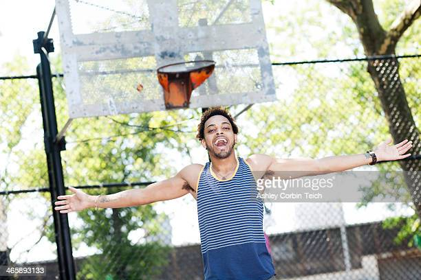 Young man celebrating on basketball court