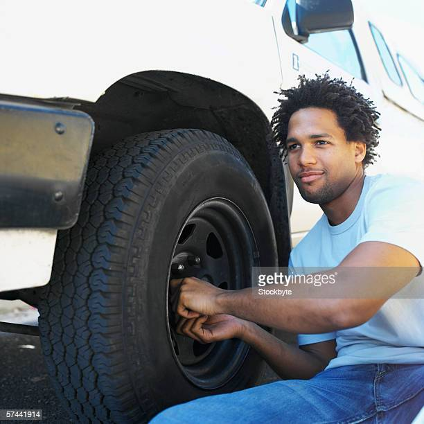 Young man changing a tyre