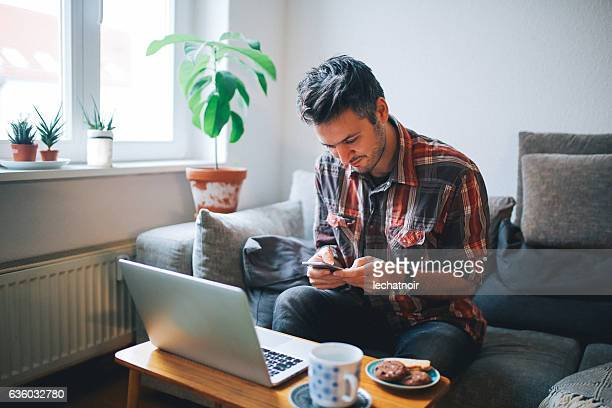 Young man checking phone messages