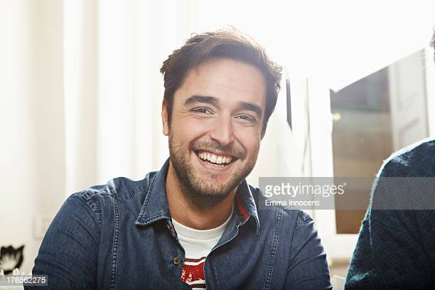 Young man cheerful indoors