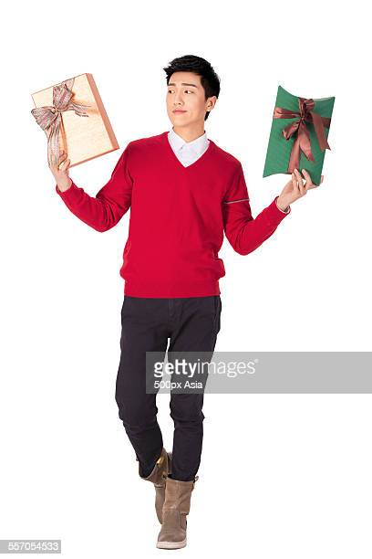 Young Man Choosing Gifts