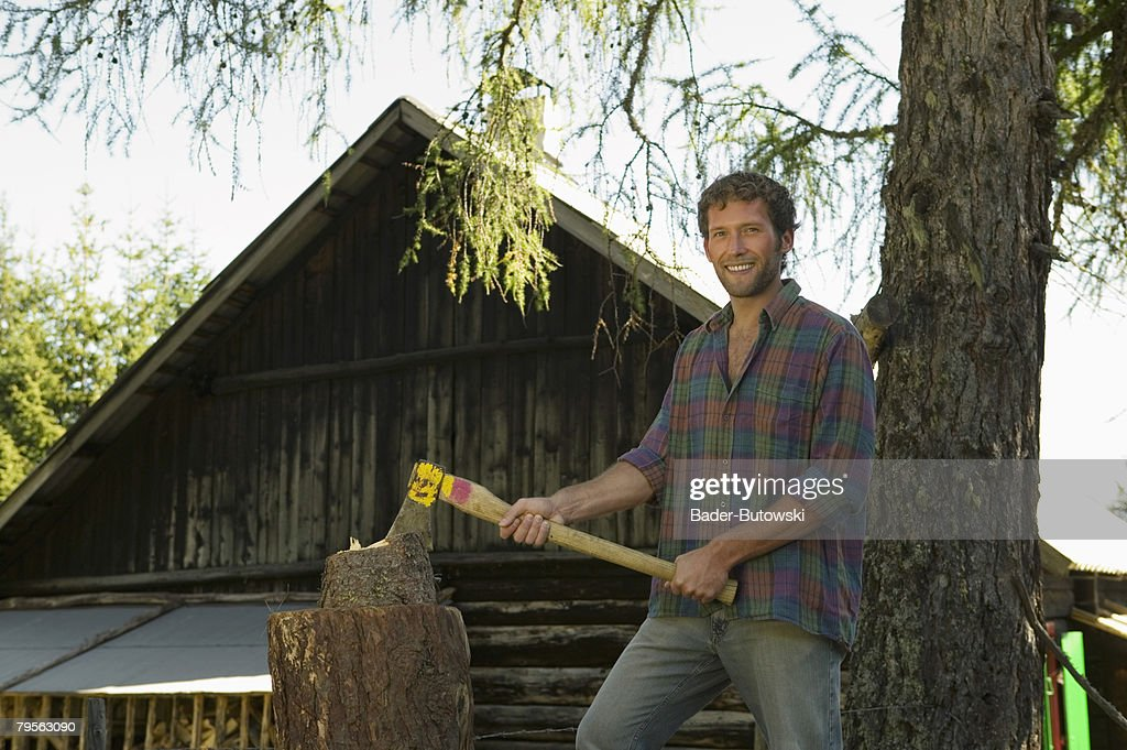 Young man chopping wood