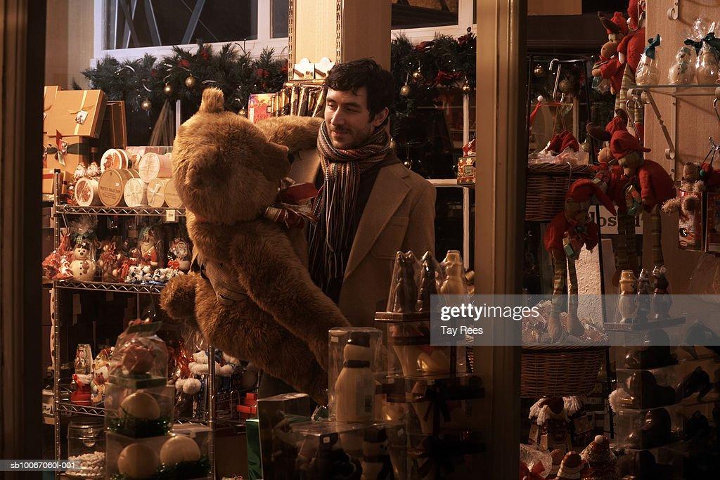 Young man Christmas shopping : Stock Photo