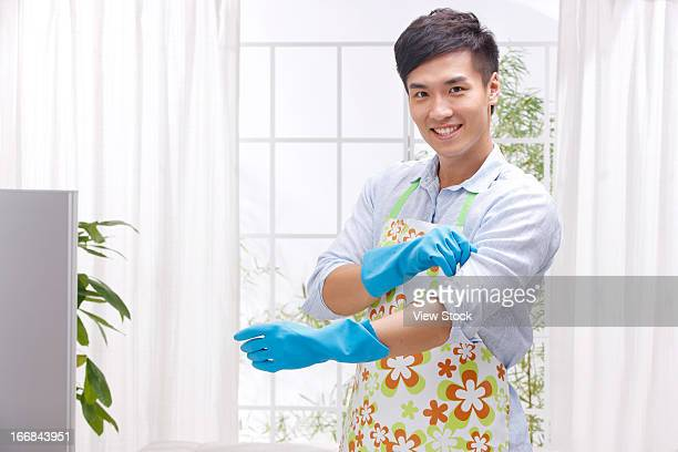 Young man cleaning room
