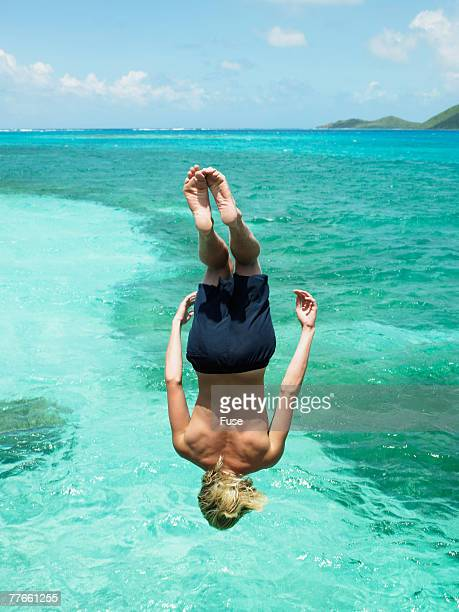 Young Man Cliff Diving