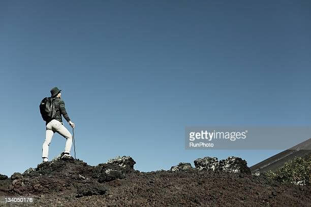 young man climbing the mountain
