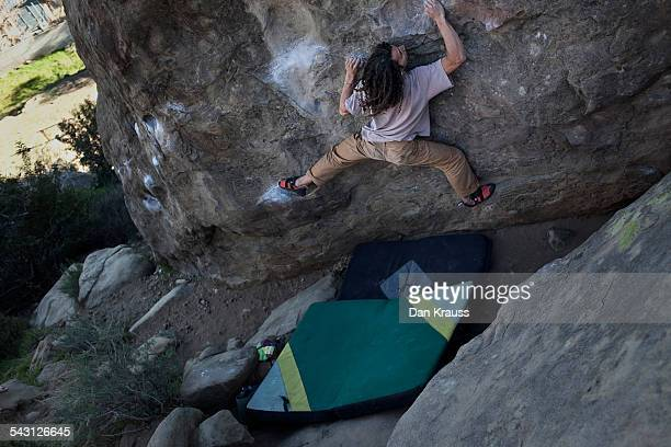 Young man climbs at Stoney Point.