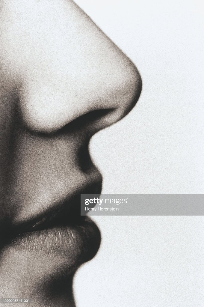 Young man, close-up, profile (grainy, B&W) : Stock Photo