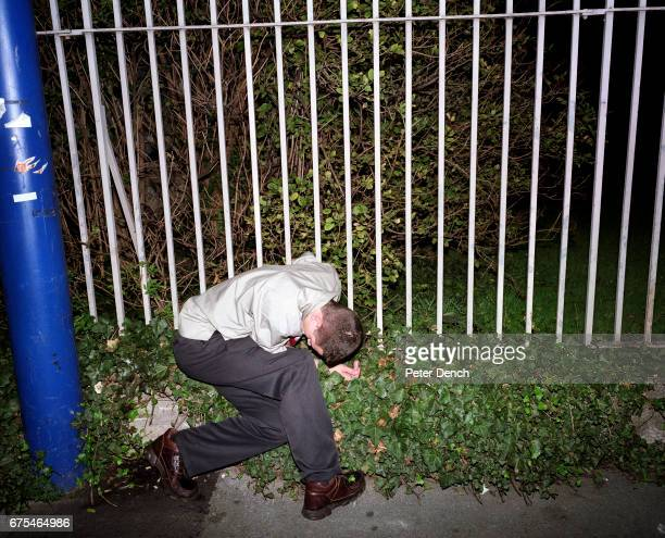 A young man collapsed by a fence on Union Street in Plymouth October 2001