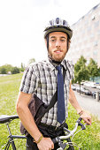 Young man commuting with bicycle