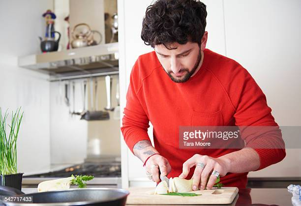 Young man cooking at home