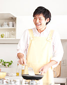 A young man cooking