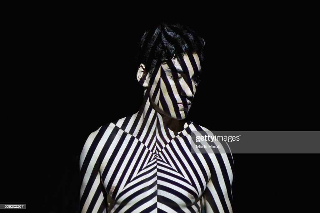 Young man Covered by Abstract Patterns of Light