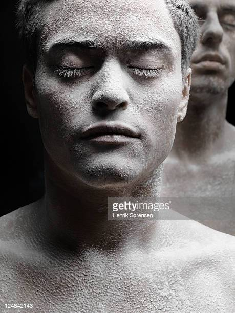 young man covered in white powder