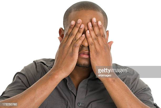 Young Man Covering Eyes With Hands
