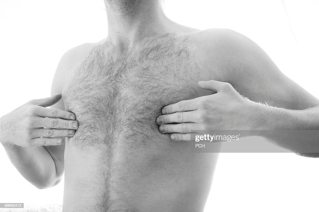 Young man covering nipples : Stock Photo