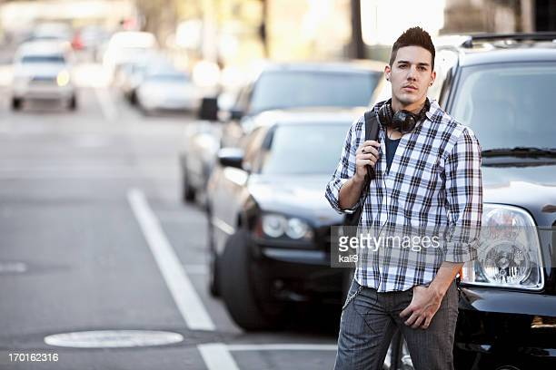 Young man crossing city street