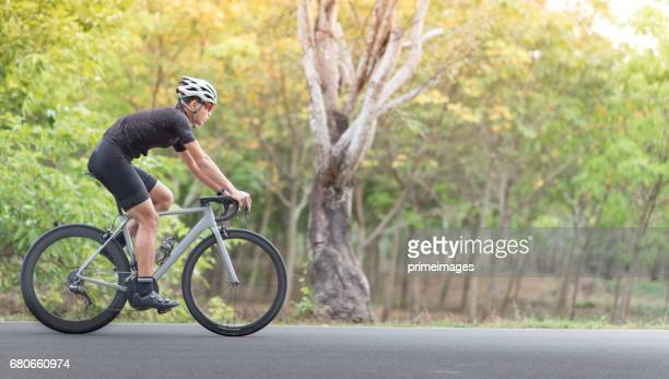 Young man Cyclist riding mountain bike on trail at moring
