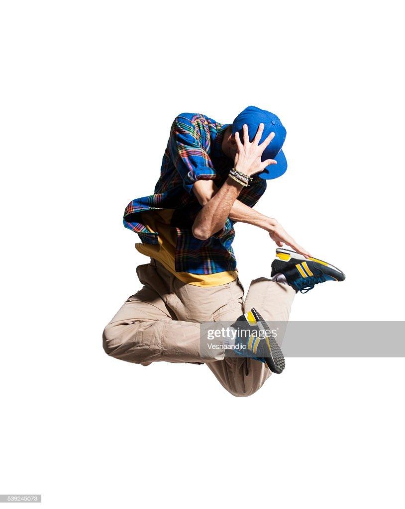 Young man dancer makes jump