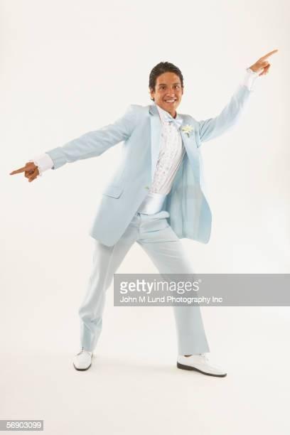 Young man dancing in tuxedo