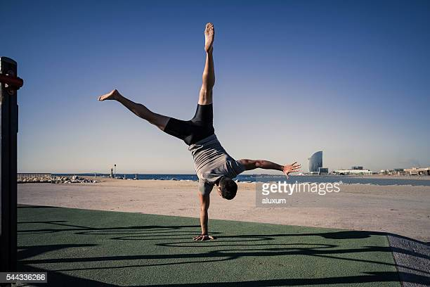 Young man doing a headstand