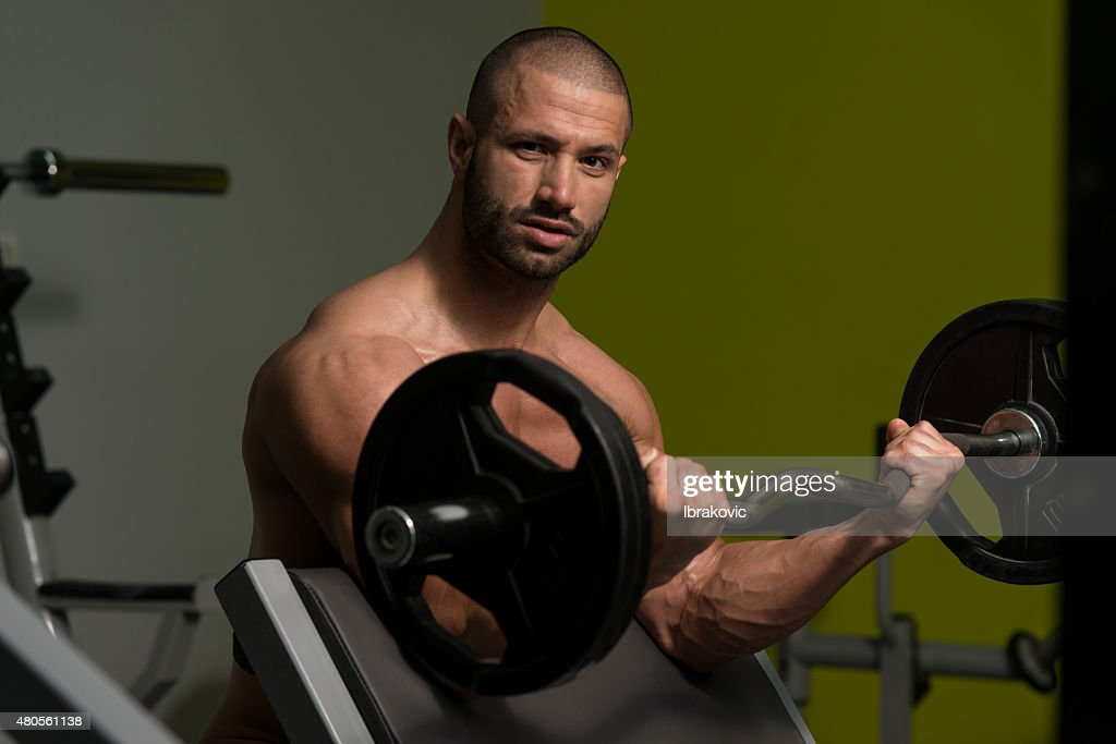 Young Man Doing Exercise For Biceps : Stock Photo