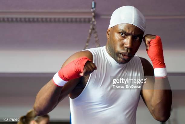 Young Man Doing Kick Boxing Training