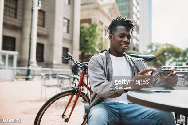 Young Man Doing Remote Deposit Capture of Check