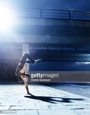 young man dooing handstand on the street : Stock Photo