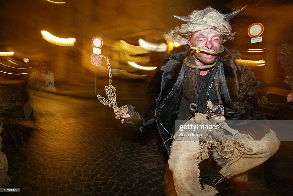 A young man dressed as a devil dances in the street December 5, 2003 in central Prague, Czech Republic. Devils, angels and St. Nicholases were out in full force, roaming the streets to reward children who have been good and admonish those who have not in the annual Czech tradition known as Svaty Mikulas.