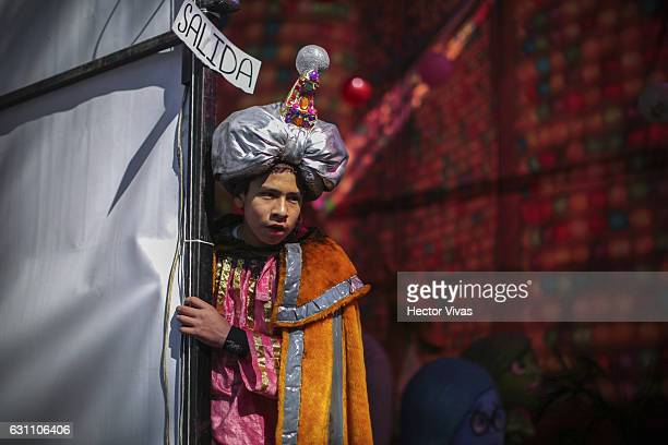 A young man dressed as Wise Man observes during the Three Wise Man celebration on January 06 2017 in Mexico City Mexico The Three Wise Man day also...