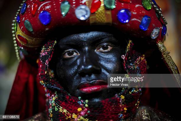 A young man dressed as Wise Man pose during the Three Wise Man celebration on January 06 2017 in Mexico City Mexico The Three Wise Man day also known...
