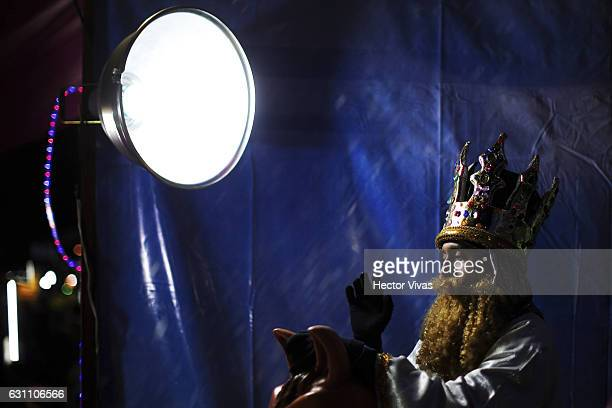 A young man dressed as Wise Man poses during the Three Wise Man celebration on January 06 2017 in Mexico City Mexico The Three Wise Man day also...