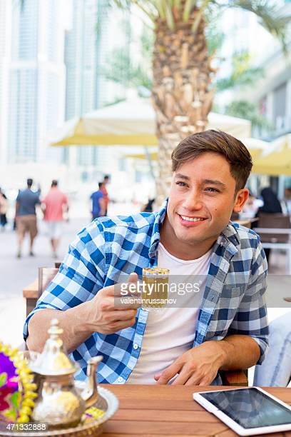 Young man drink traditional tea in Dubay
