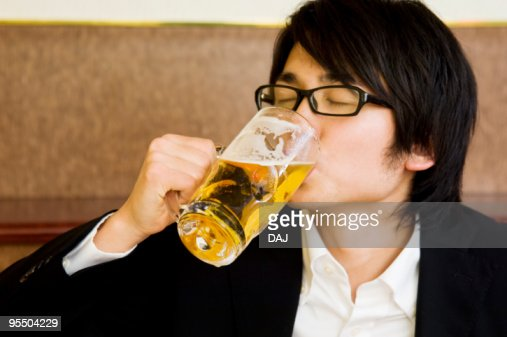 Young man drinking beer : Stock Photo