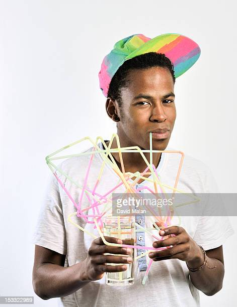young man drinking through connected straws