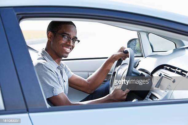 Young man driving car