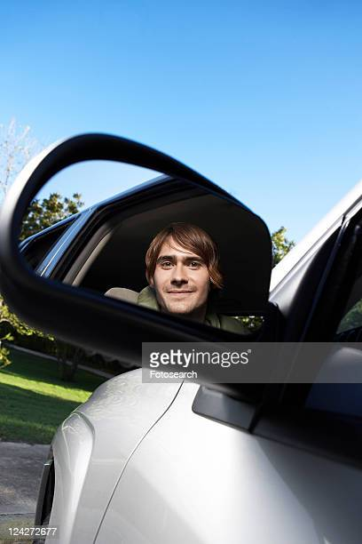 Young Man Driving Car, Reflection in Side Mirror