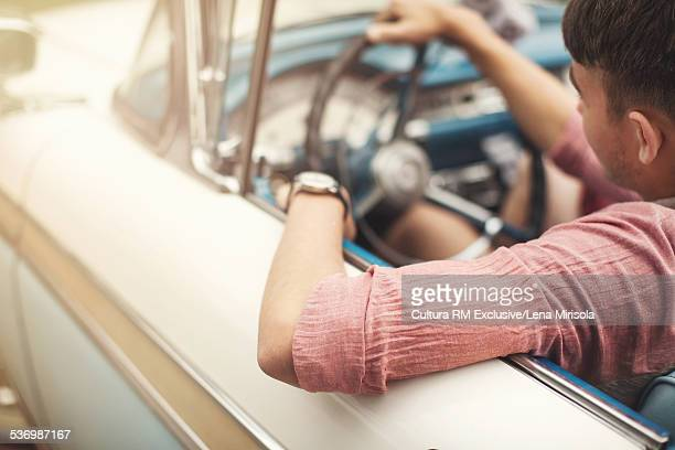 Young man driving convertible
